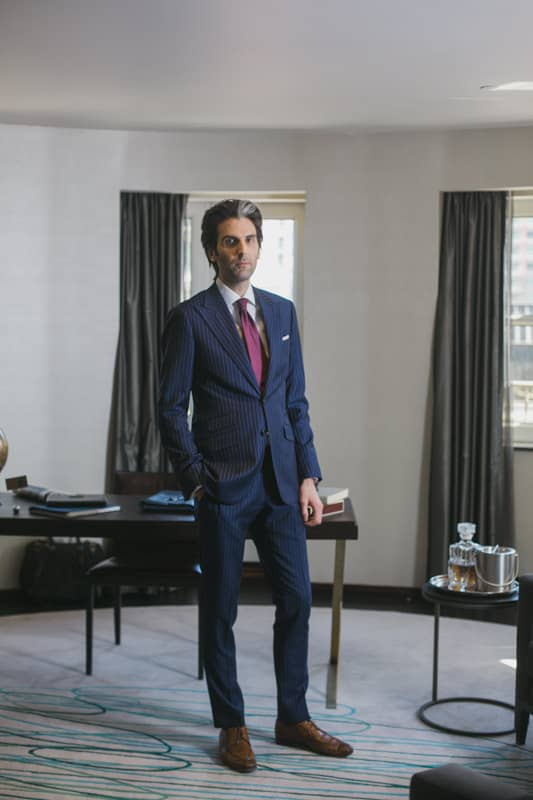 custom tailored pinstripe suit by garrison bespoke full standing pose