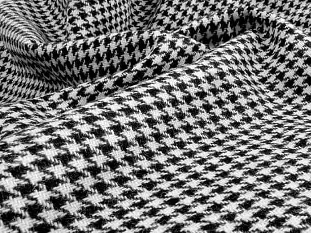Beautiful black and white wool houndstooth swirled.